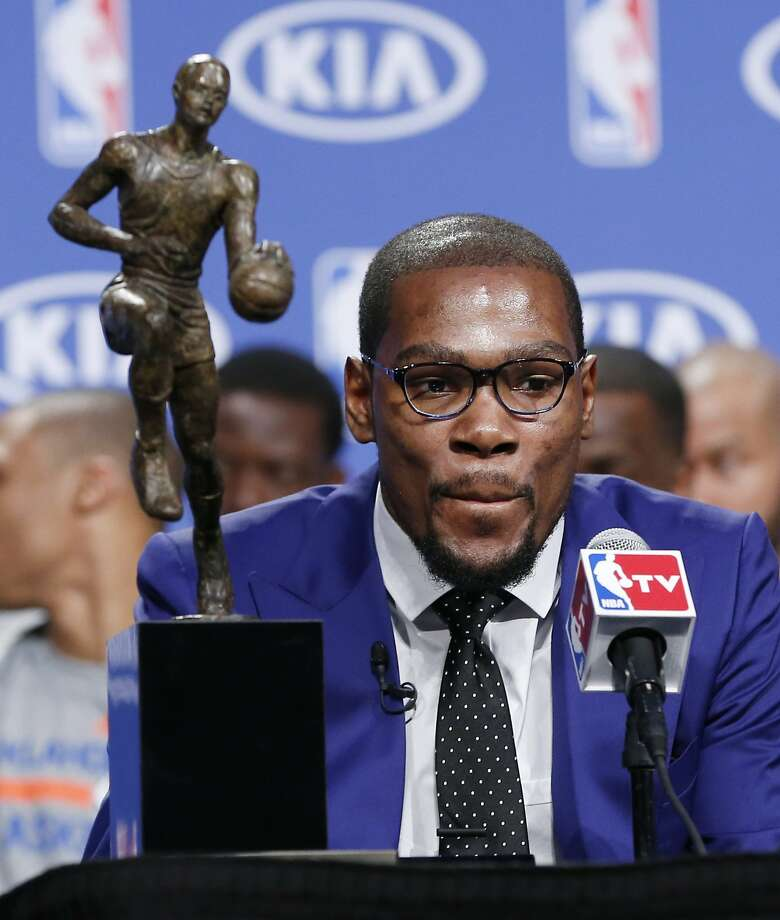 Forward Kevin Durant talks about his first MVP trophy. Photo: Sue Ogrocki, Associated Press