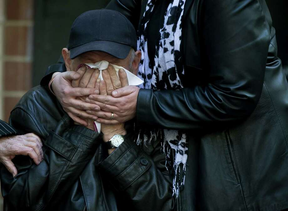 An elderly relative is comforted Tuesday as the coffin of 17-year-old Vadim Papura is brought outside the apartment block he lived in, in Odessa, Ukraine. Papura died after jumping out of the burning trade union building on Friday. Photo: Vadim Ghirda, STR / AP