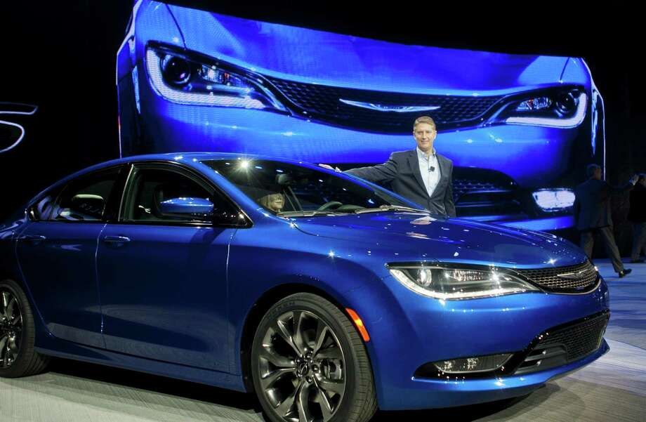 Chrysler President and CEO Al Gardner poses with a newly unveiled 2015 Chrysler 200 sedan, Monday, Jan. 13, 2014, at the North American International Auto Show in Detroit, Mich. Photo: Tony Ding, FRE / FR143848 AP