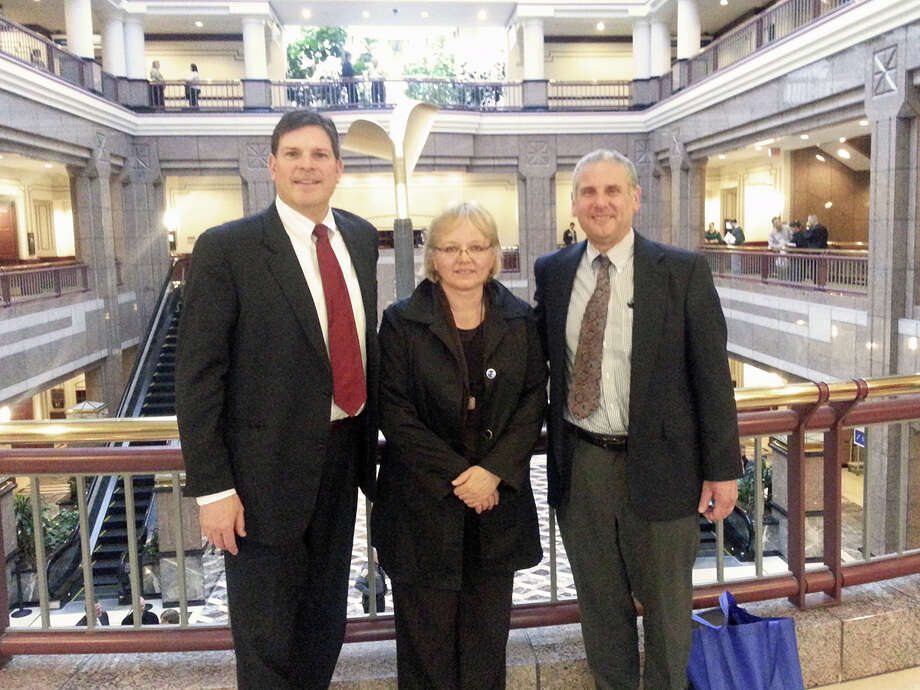 State Rep. Tom O'Dea with Ingrid Gillespie of the Connecticut Prevention Network and New Canaan resident Jeff Holland following a unanimous vote in the House of Representatives to extend immunity from criminal prosecution to those administering the anti-overdose drug naloxone. Photo: Contributed Photo, Contributed / New Canaan News Contributed