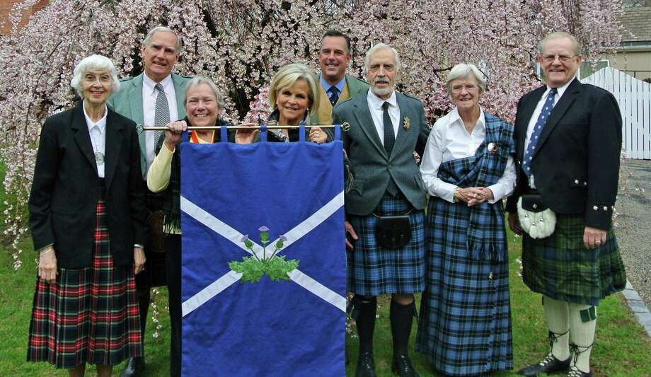 Planning committee members of the annual Scottish Heritage Service at First Presbyterian Church surround the saltire. Photo: Contributed Photo, Contributed / New Canaan News Contributed