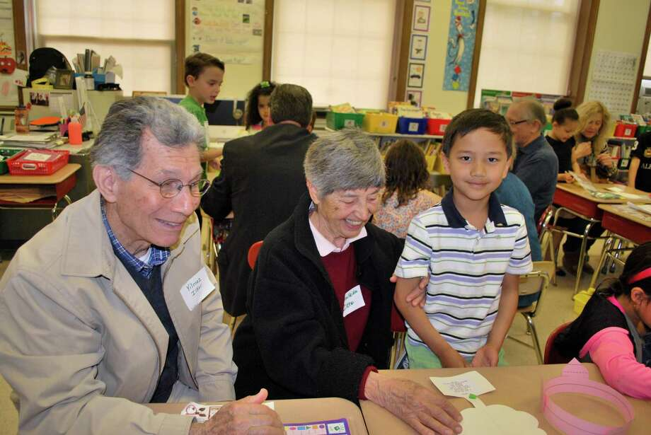 Grandpa and grandma Yilmaz and Reinfriede Ilker visit grandson Kaiser Ilker, a first grader, during the Julian Curtiss School's recent celebration of Grandparents Day. Photo: Contributed Photo / Greenwich Time Contributed