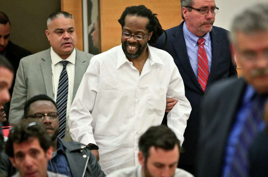 """Robert Hill, center, said Tuesday that he hopes to work as a youth counselor now that he and two half-brothers have been exonerated of murder in Brooklyn over questions about tactics used by police in the 1980s. """"I feel all right,"""" Hill said. Photo: Bebeto Matthews, STF / AP"""