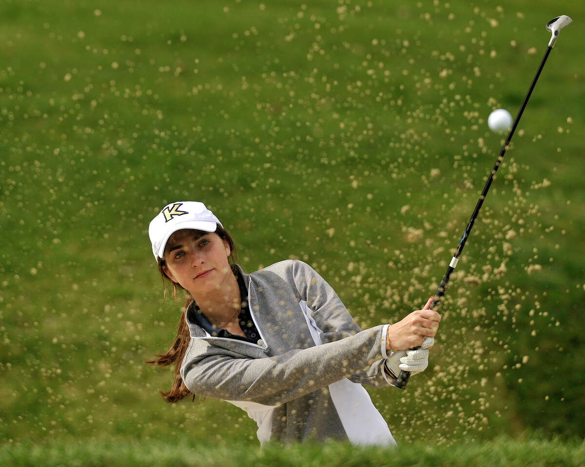 King School's Lauren Martin digs her way out of a sand trap on the second hole during the King School, Holy Child and Greenwich Academy golf match at Greenwich Country Club in Greenwich, Conn., on Tuesday, May 6, 2014.
