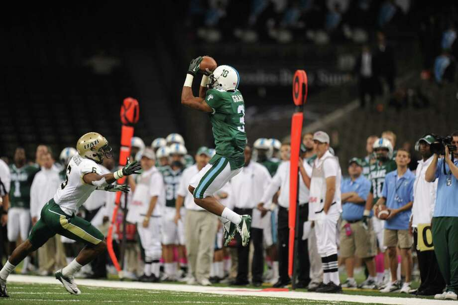 West Brook grad Ryan Grant leaps for a catch in Tulane's game against Alabama-Birmingham on October 23 in the Louisiana Superdome. Grant is expected to be drafted between the fourth and seventh rounds of this week's NFL Draft. Photo: Courtesy Of Tulane Athletics