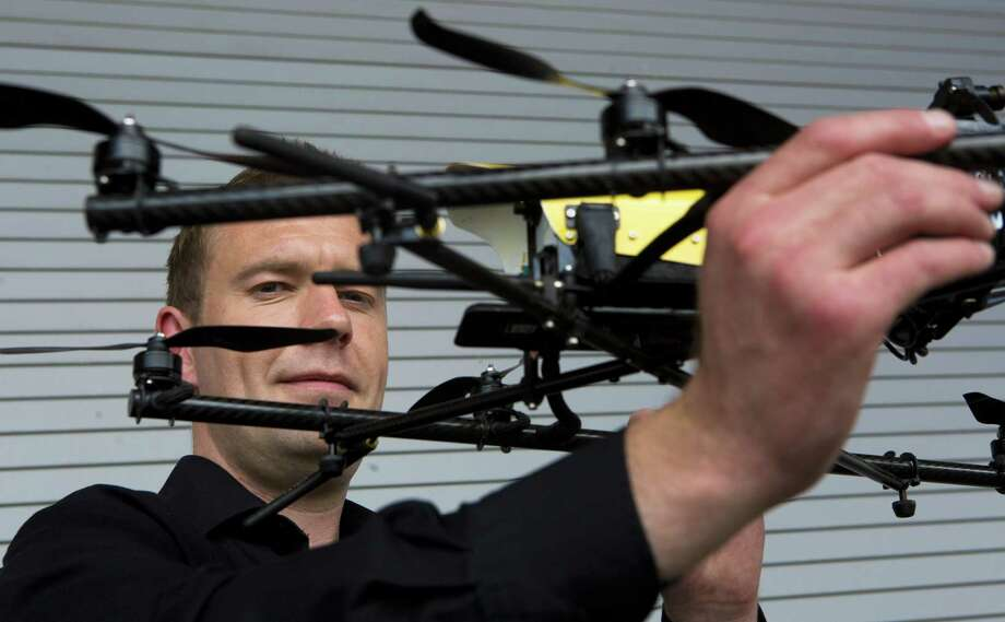 Malcolm Connolly, founder of Cyberhawk, a company specializing in aerial inspection and surveying with remote-controlled aircraft, holds a product at the Offshore Technology Conference in Houston. Photo: Photos By Marie D. De Jesus / Houston Chronicle / © 2014 Houston Chronicle