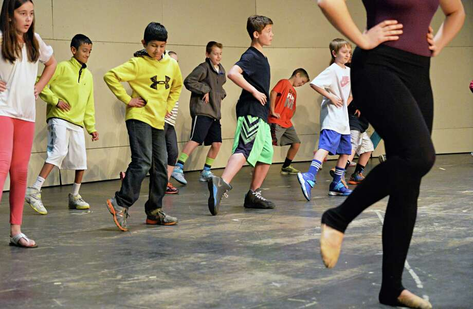 North Colonie Elementary School students dance on stage during Saratoga Performing Arts Center's Classical Kids program, presented by Union College at Shaker High School Tuesday May 6, 2014, in Colonie, N.Y.  (John Carl D'Annibale / Times Union) Photo: John Carl D'Annibale / 00026764A