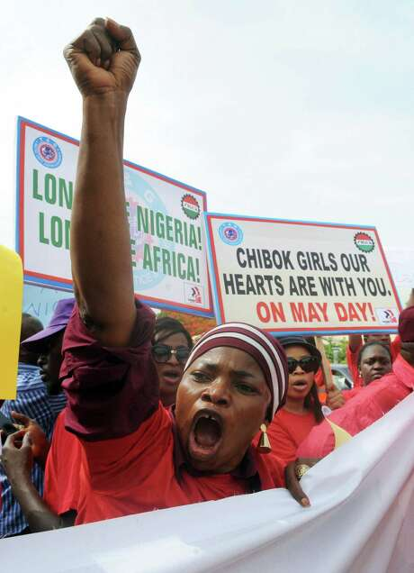 People protest the abduction of schoolgirls and rally for their release in Abuja, Nigeria. On Tuesday, they marched through the streets of Abuja and to the Nigerian defense headquarters to meet with military chiefs. Photo: Pius Utomi Ekpei / / AFP