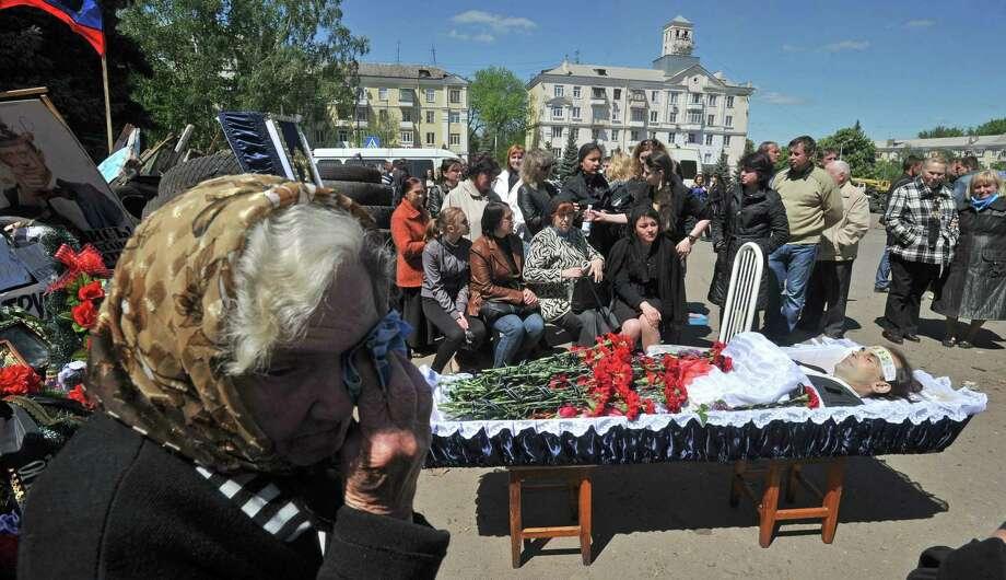 A funeral is held for a pro-Russian activist killed during combat with Ukrainian troops in Kramatorsk, eastern Ukraine, amid fresh warnings of civil war. Photo: Genya Savilov / Getty Images / GENYA SAVILOV