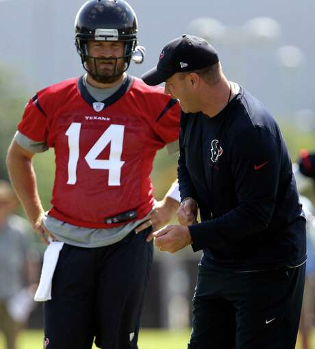 "New Texans quarterback Ryan Fitzpatrick, left, will absorb everything coach Bill O'Brien throws at him because he ""attacks the game from a mental side."" Photo: James Nielsen, Staff / © 2014  Houston Chronicle"