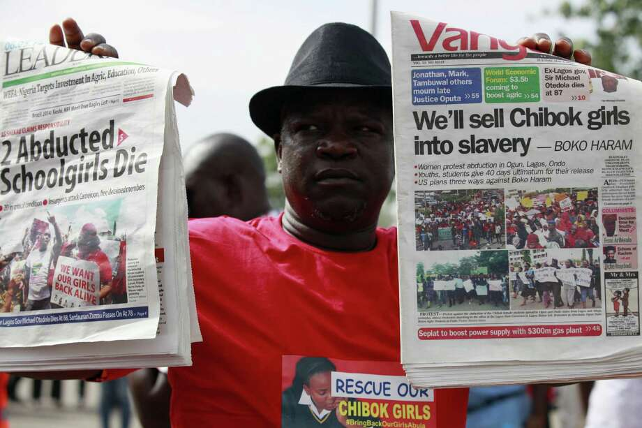 Daily demonstrations and huge headlines reflect the impact the kidnappings of schoolgirls by radical Islamists have had on Nigeria and its secular government. The abductions are a huge blow to a nation hosting a meeting of African leaders. Photo: Sunday Alamba, STF / AP