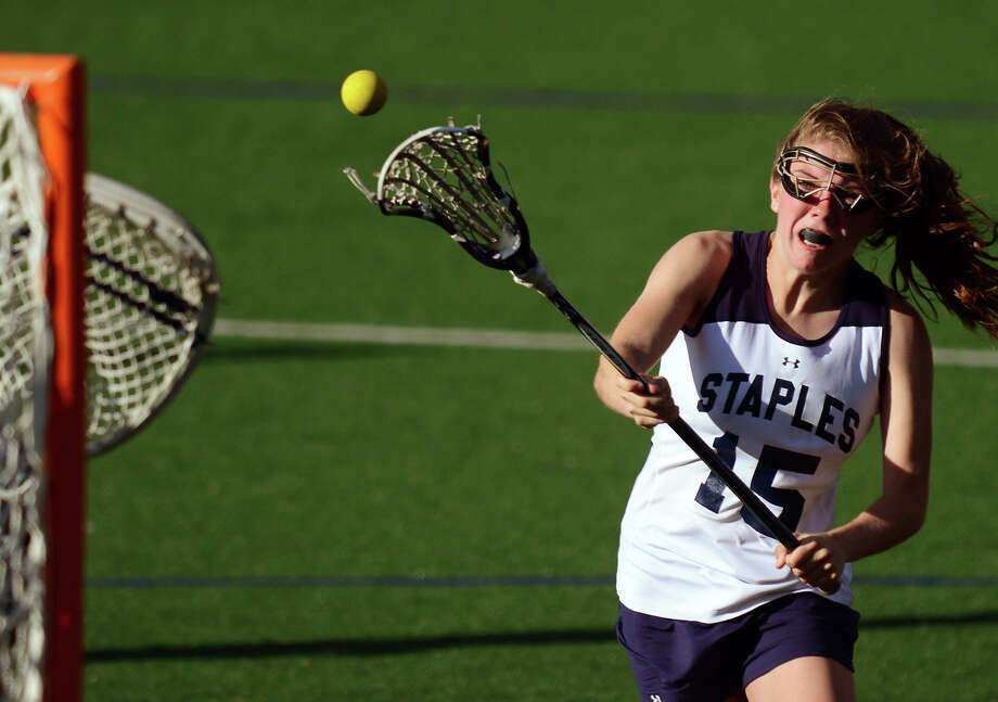 Staples' Kathryn Lesch attempts a goal shot, during girls lacrosse action against Wilton in Westport, Conn. on Tuesday May 6, 2014. Photo: Christian Abraham / Connecticut Post
