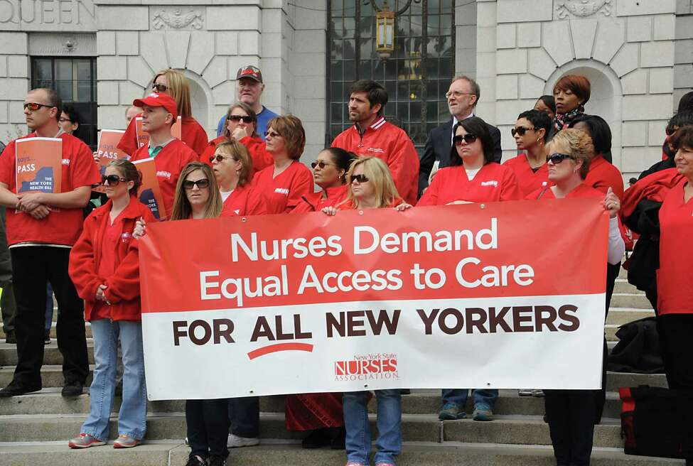 People participate in a rally in support of the New York Health bill, which creates a universal, single-payer health insurance program outside the Capitol on Tuesday May 6, 2014 in Albany, N.Y. (Lori Van Buren / Times Union)