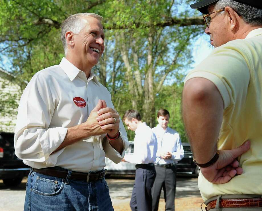 From left, N.C. House Speaker Thom Tillis talks with voter Donald Parrott of Charlotte outside Precinct 75 at Holy Covenant UCC in Charlotte on Tuesday, May 6, 2014. Tillis is running in the highest-profile race.   (AP Photo/The Charlotte Observer, Jeff Siner) MAGS OUT; TV OUT; NEWSPAPER INTERNET ONLY Photo: Jeff Siner, MBI / The Charlotte Observer
