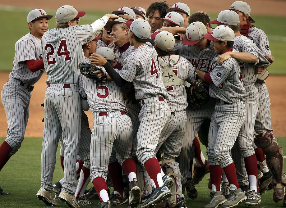 The Lowell Cardinals swarm winning pitcher Craig Colen on the infield at AT&T Park. Photo: Michael Macor, The Chronicle