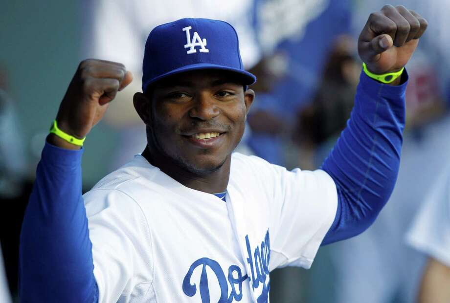 Los Angeles Dodgers' Yasiel Puig talks with teammates in the dugout prior to a baseball game against the San Francisco Giants on Sunday, April 6, 2014, in Los Angeles. (AP Photo/Alex Gallardo) Photo: Alex Gallardo, FRE / FR170211 AP