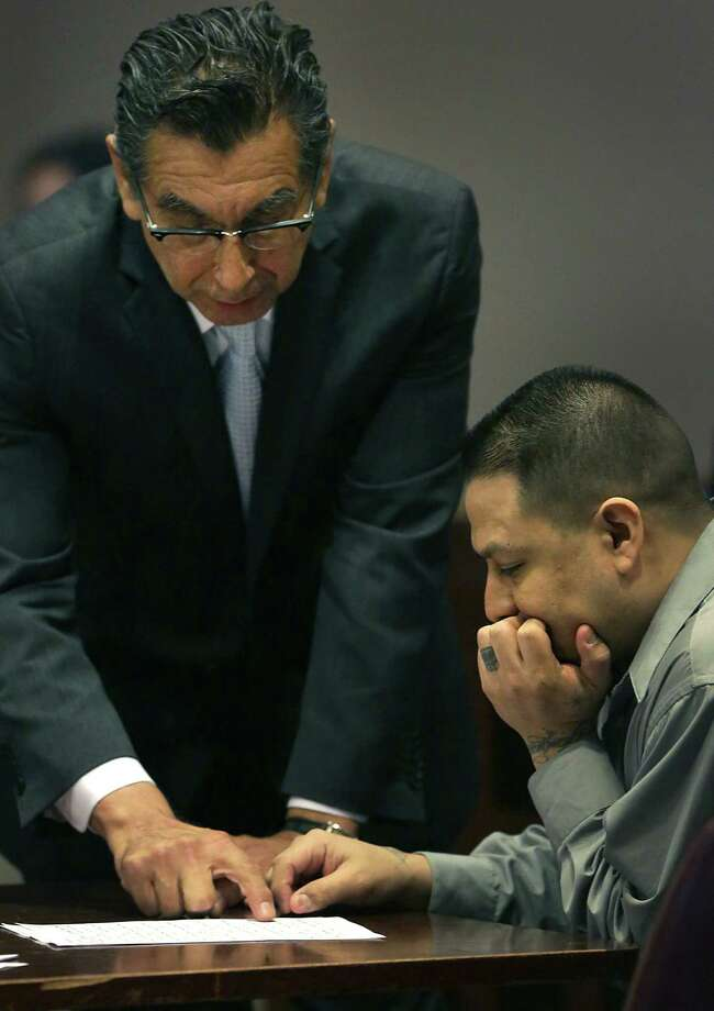 A jury determined that Andres Segovia (right), conferring with defense attorney Tony Jimenez, merited a 55-year prison sentence for murdering Joel Flores in June 2012. Photo: Bob Owen / San Antonio Express-News / © 2012 San Antonio Express-News
