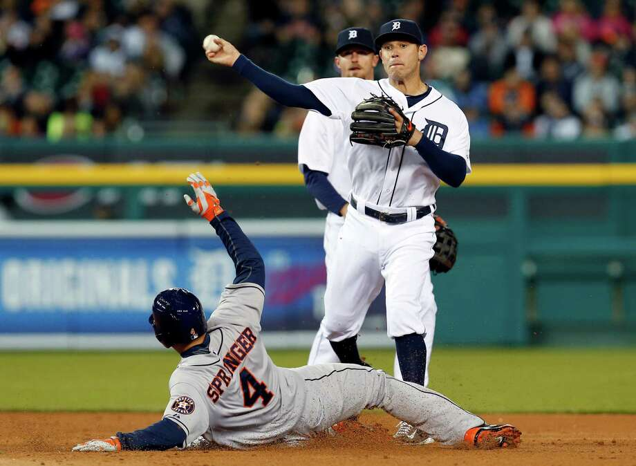 George Springer (4) had a busy night on the bases, trying unsuccessfully to break up Ian Kinsler's turning of a double play after a seventh-inning single that was one of Springer's three hits Tuesday. Photo: Paul Sancya, STF / AP