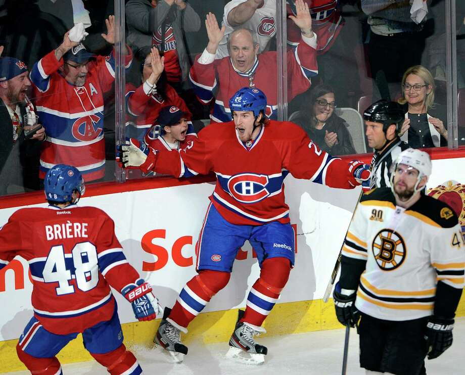 Montreal Canadiens right wing Dale Weise (22) celebrates his goal with teammate center Daniel Briere (48) as Boston Bruins defenseman Andrej Meszaros (41) looks on during the second period of Game 3 of an NHL hockey Stanley Cup playoff series, Tuesday, May 6, 2014, in Montreal. (AP Photo/The Canadian Press, Ryan Remiorz) ORG XMIT: RYR108 Photo: Ryan Remiorz / The Canadian Press