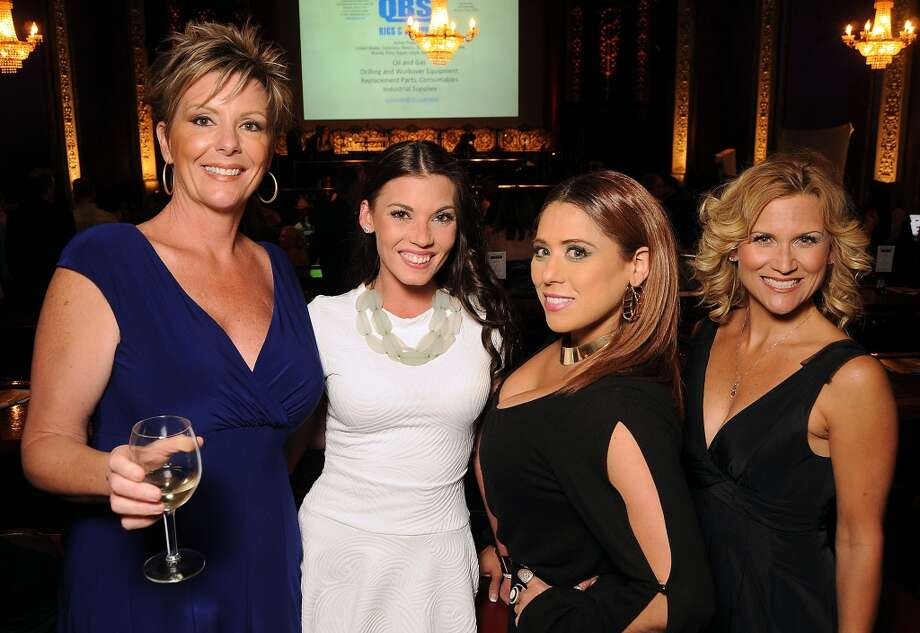 Shannon Kmiec, left, Candace Reichert, Sandy Maddox and Droxine Bruce at the Texas Oilman's Gala. Photo: Dave Rossman, For The Houston Chronicle