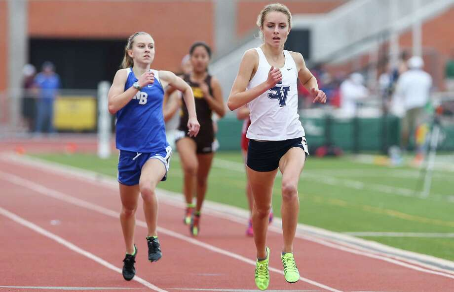 New Braunfels' Paige Hofstad (left) says she is driven by Smithson Valley's Devin Clark (right), and vice versa. They'll go at it again at the UIL state meet. Photo: Marvin Pfeiffer / San Antonio Express-News / Express-News 2014