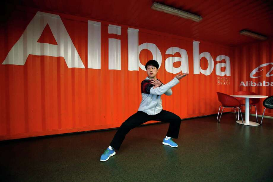 A worker performs shadow boxing at an open house last year at the Alibaba office in Hangzhou in eastern China. Alibaba aims to raise $1 billion in an IPO. Photo: Uncredited, STR / CHINATOPIX