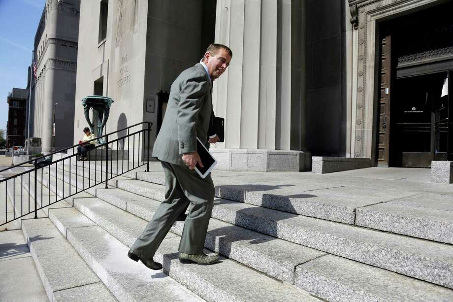 Former Anheuser-Busch CEO August Busch IV enters the Civil Court building before testifying in a gender discrimination lawsuit Tuesday, May 6, 2014, in St. Louis. Francine Katz, former vice president of communications and consumer affairs for the maker of Budweiser, Bud Light and other beers, is suing Anheuser-Busch for gender discrimination. (AP Photo/Jeff Roberson) Photo: Jeff Roberson, STF / AP