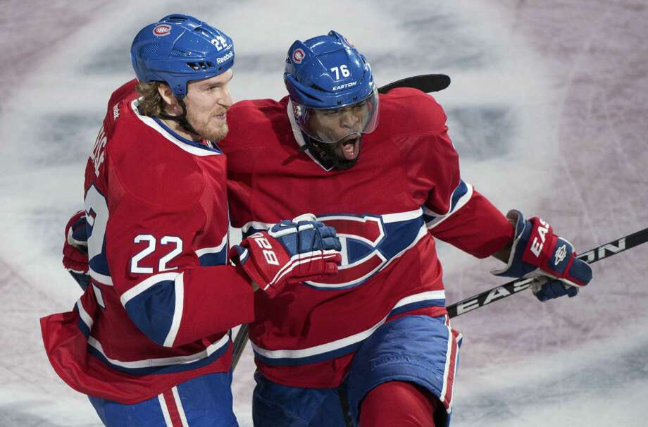 Montreal's P.K. Subban (right), the subject of racist tweets from Boston fans after scoring in double OT to win Game 1, celebrates with Dale Weise after scoring in Tuesday's Game 3 victory. Photo: Paul Chiasson / Associated Press / The Canadian Press