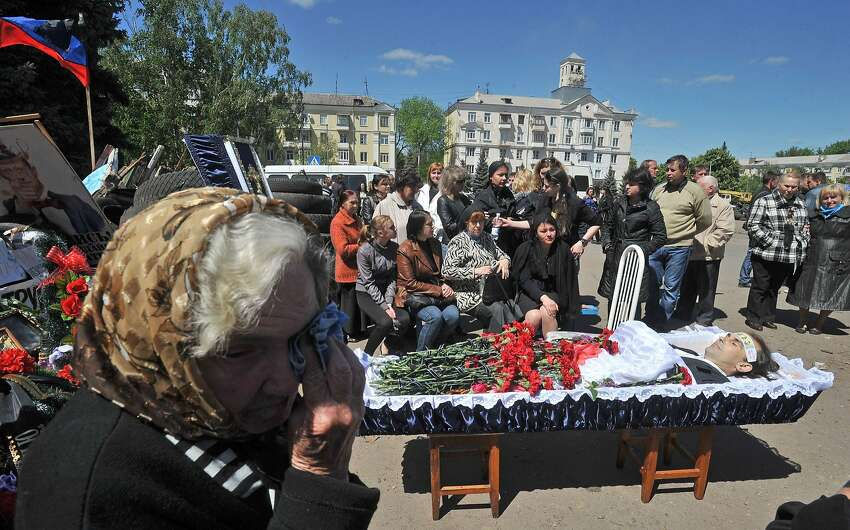 TOPSHOTS People mourn during the funeral ceremony for a pro-Russian activist killed during combat with Ukrainian troops in Kramatorsk, eastern Ukraine, on May 6, 2014. The death toll from a military offensive in a flashpoint town in east Ukraine rose to at least 34, officials said on May 6, amid fresh warnings of civil war and the shutdown of a major airport in the region. AFP PHOTO/ GENYA SAVILOVGENYA SAVILOV/AFP/Getty Images