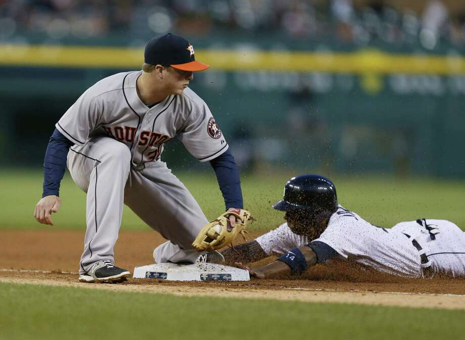 Astros third baseman Matt Domin-guez applies a late tag as the Tigers' Austin Jackson steals third before scoring on a sacrifice fly in the fourth to give Detroit a 4-0 lead. Photo: Julian H. Gonzalez, MBR / Detroit Free Press