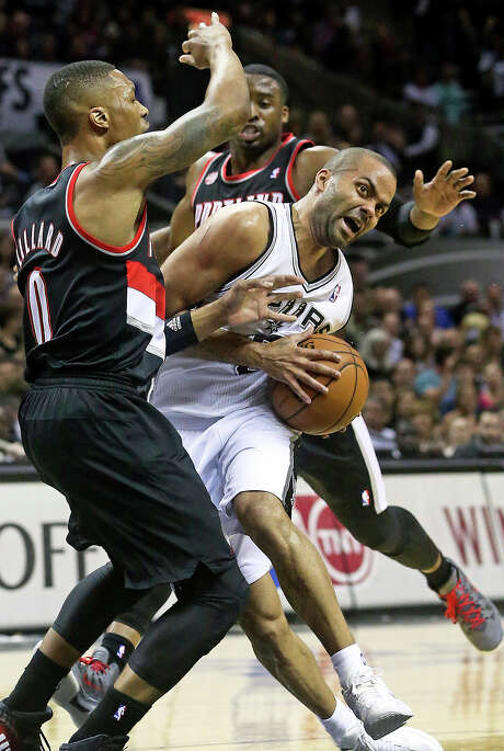 Like the game itself, the point guard battle between Tony Parker and Damion Lillard was one-sided, with Parker outscoring Lillard 33-17. Photo: TOM REEL