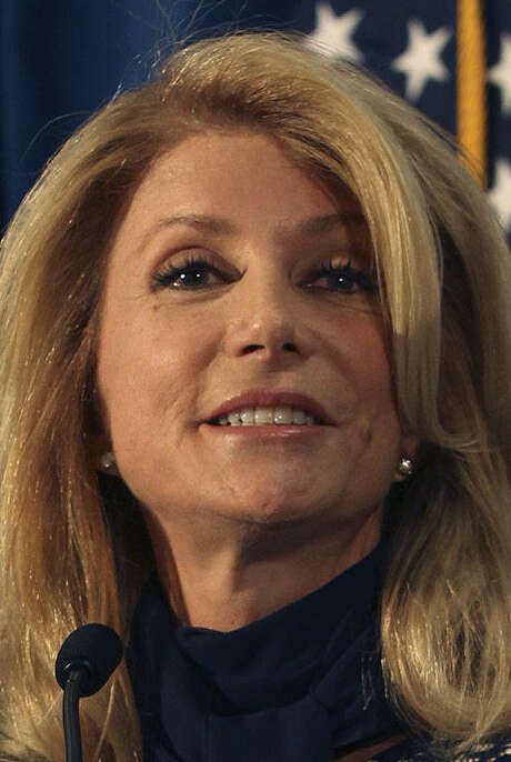 Democrat Wendy Davis accused her foe of abandoning his watchdog role at CPRIT in a way that betrayed Texans and aided donors. / ©San Antonio Express-News/John Davenport