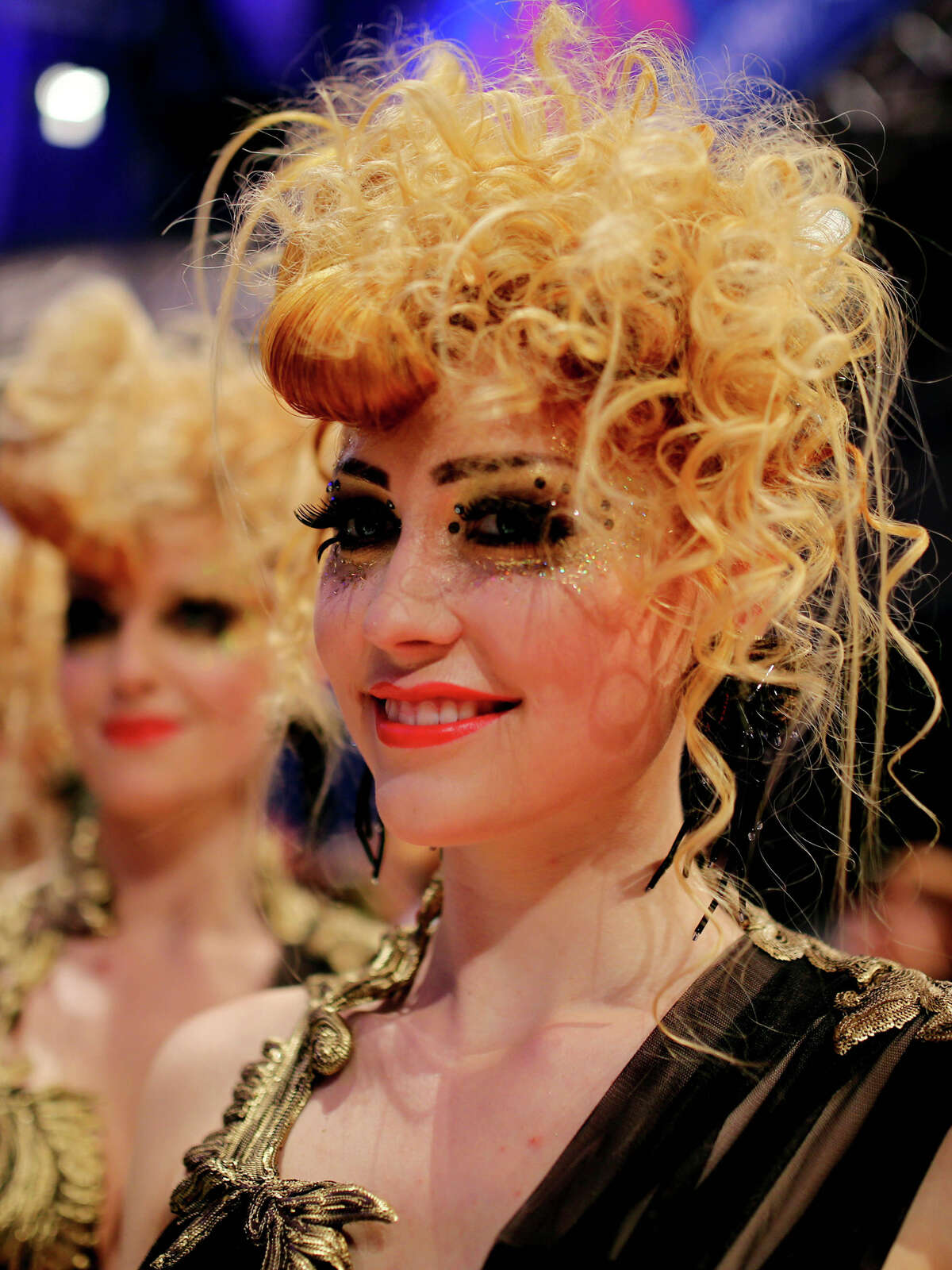 Models walk on the podium during the OMC Hairworld World Cup contest on May 5, 2014 in Frankfurt am Main, Germany.