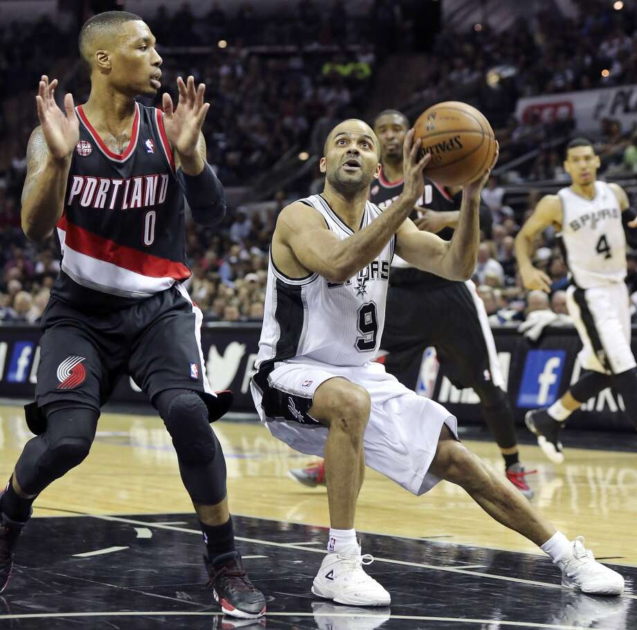 San Antonio Spurs' Tony Parker drives around Portland Trail Blazers' Damian Lillard during second half action of Game 1 in the Western Conference semifinals Tuesday May 6, 2014 at the AT&T Center. The Spurs won 116-92. Photo: Edward A. Ornelas, San Antonio Express-News