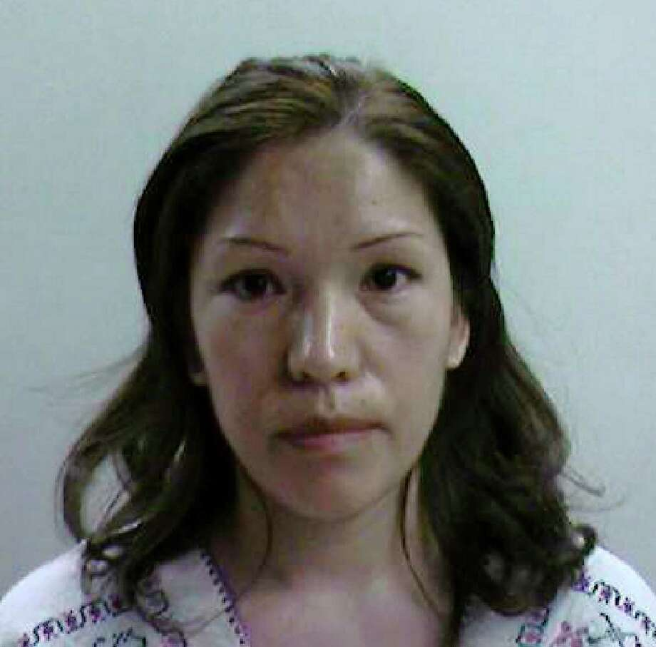 In this booking photo released by Immigration and Customs Enforcement, Elvira Arellano is shown after her arrest in Los Angeles August 19, 2007. Arellano, a Mexican woman who fought deportation from the United States by claiming sanctuary in a Chicago church was arrested in Los Angeles on Sunday, the U.S. Immigration and Customs Enforcement said.  Photo: HO, REUTERS / X80001