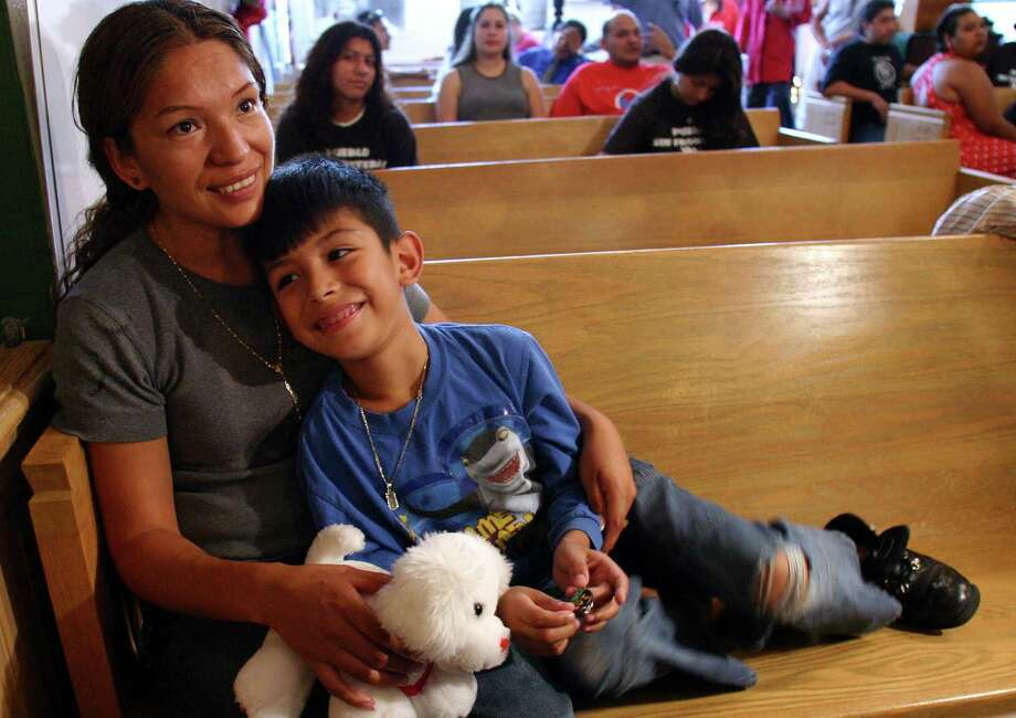 Elvira Arellano, left, sits with her 7-year-old son Saul Arellano on a pew inside Adalberto United Methodist Church in Chicago in this Tuesday, Aug. 15, 2006 file photo. The 7-year-old son of the immigration activist who took refuge in a church to avoid being deported to Mexico is heading to that country Sunday to seek the support of national legislators. Saul Arellano, who is an American citizen, is scheduled to meet with members of the Mexican House of Representatives and the Mexican Senate on Tuesday in an effort to get a resolution supporting Elvira Arellano's bid to stay in the United States. Photo: JULIO CORTEZ, AP / AP