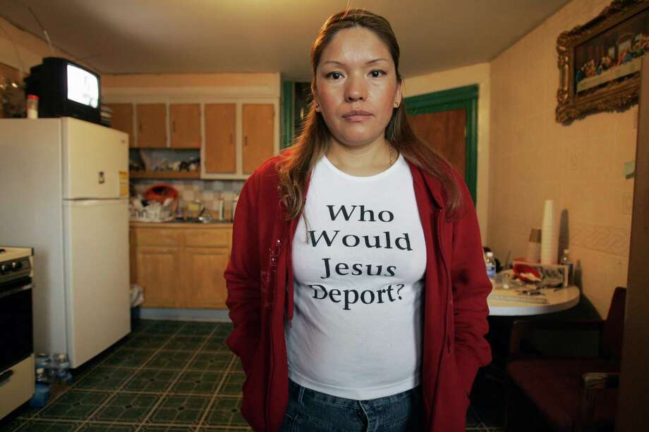 "Elvira Arellano sports a ""Who Would Jesus Deport?"" T-shirt in the upstairs apartment of the Adalberto United Methodist Church in Chicago, Tuesday, Nov. 14, 2006. Arellano is illegal immigrant who has taken refuge in the church. Her 7-year-old son Saul, a U.S. citizen, appeared in Mexico's 500-member Chamber of Deputies Tuesday to plead for help in lobbying Washington to stop the deportation of his mother. Photo: CHARLES REX ARBOGAST, AP / AP"