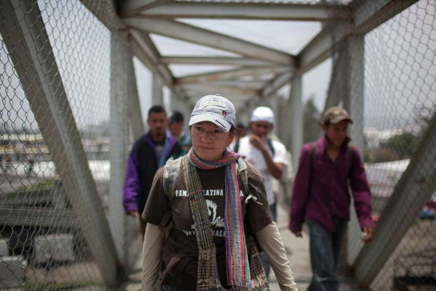 In this May 17, 2012 photo, immigrant rights activist Elvira Arellano walks with Central American migrants toward the city mayor's home to protest violence against migrants, in Lecheria, on the outskirts of Mexico City. While the number of Mexicans heading to the U.S. has dropped dramatically, a surge of Central American migrants is making the 1,000-mile northbound journey this year, fueled in large part by the rising violence brought by the spread of Mexican drug cartels.