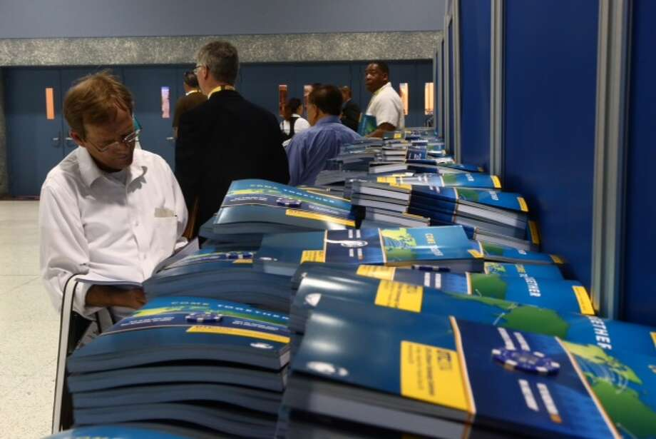 An OTC attendee reviews the convention's program, Wednesday, May 7, 2014. (Marie D. De Jesus / Houston Chronicle)