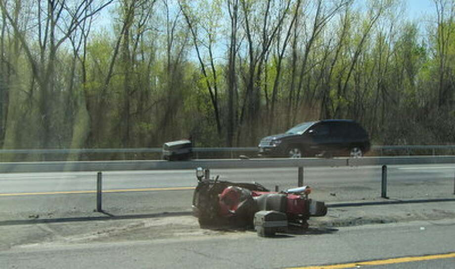 State Police investigate a motorcycle accident on I787 in Menands. (Bob Gardinier/Times Union) Photo: Picasa