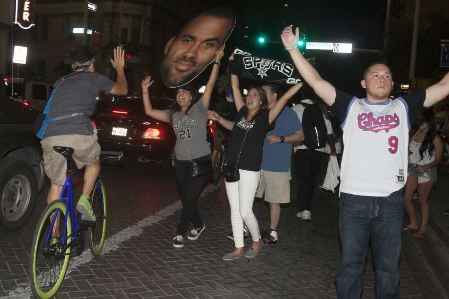 Fans gather downtown after the Spurs lost the NBA Finals against the Miami Heat June 20, 2013. Photo: Express-News, File