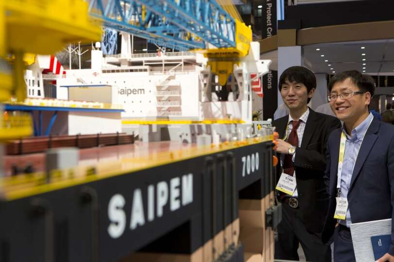 Stan Kim, center, and Seung-iL Jung, right, study the Saipem 7000, the world's second largest semisu
