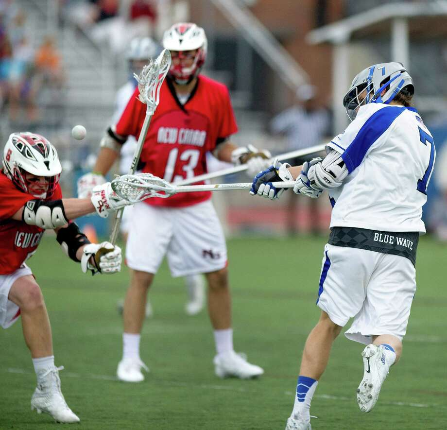 Darien's John Reed takes a shot during the Wave's boys lacrosse game against New Canaan on May 3, 2014. Photo: Lindsay Perry / Stamford Advocate