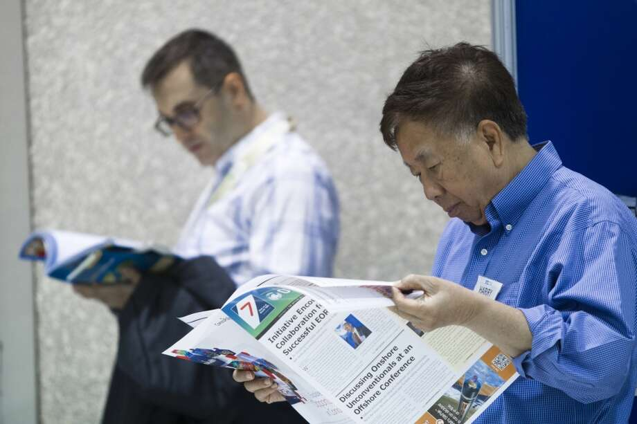 2014 Offshore Technology Conference attendees wait to get inside the exhibition floor while catching up on the conference news during the third day of OTC, Wednesday, May 7, 2014. ( Marie D. De Jesus / Houston Chronicle ) Photo: Houston Chronicle