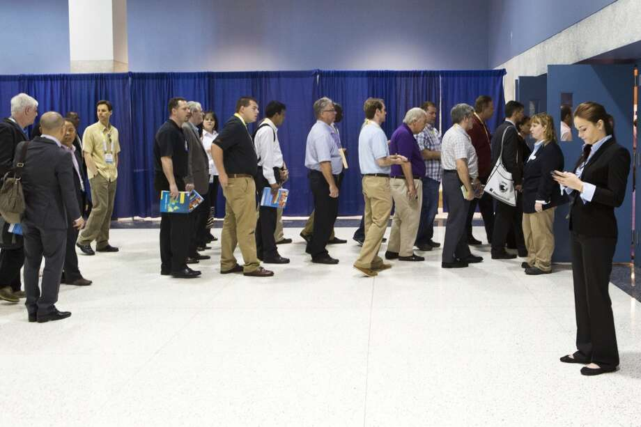 2014 Offshore Technology Conference attendees make a line to enter the offshore technology exhibition show on the first floor of the NGR Center, Wednesday, May 7, 2014, in Houston. ( Marie D. De Jesus / Houston Chronicle ) Photo: Houston Chronicle