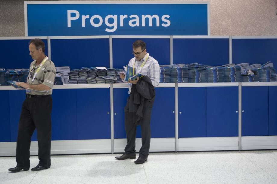 2014 Offshore Technology Conference attendees get their exhibition programs as they wait to enter the show during the third day of the conference in Houston. Wednesday, May 7, 2014. ( Marie D. De Jesus / Houston Chronicle ) Photo: Houston Chronicle