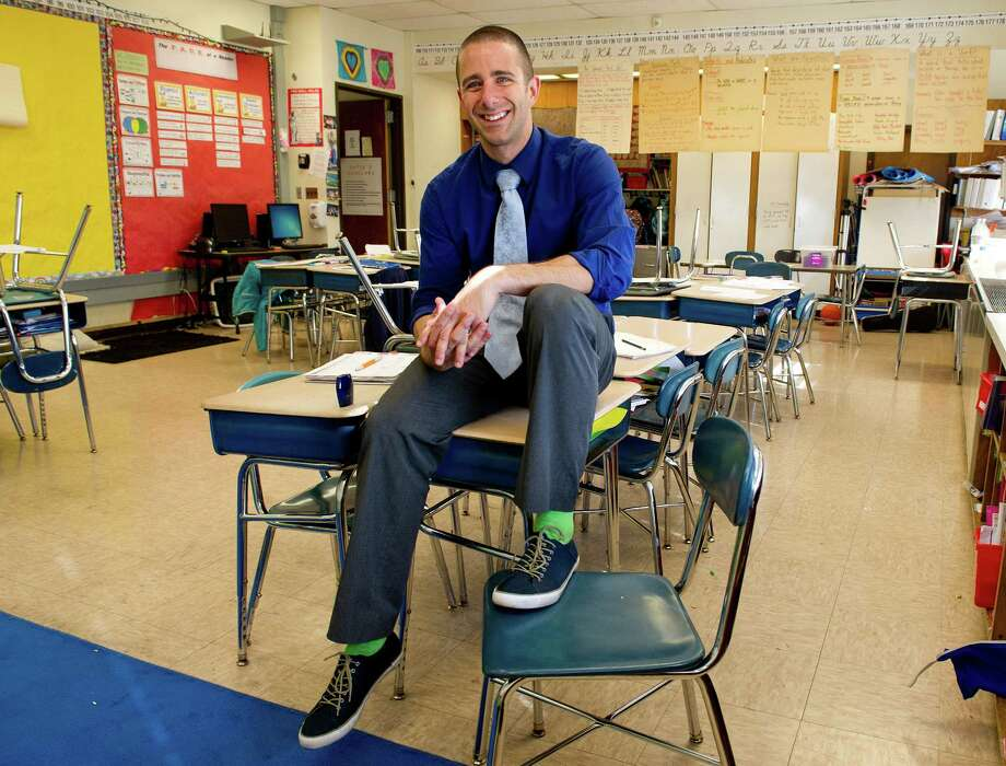 Springdale Elementary School's Jimmy Sapia poses for a photo in his classroom on Wednesday, May 7, 2014. Sapia has been named Stamford Public Schools Teacher of the Year. Photo: Lindsay Perry / Stamford Advocate