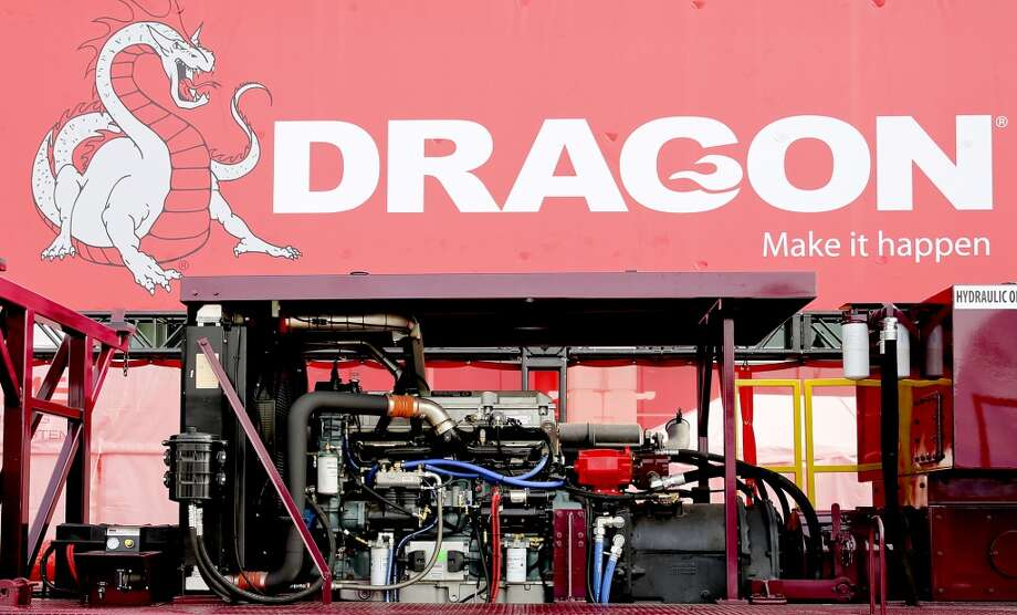 The massive engine of the Dragon mobile work over rig can be seen on day three of OTC on May 7, 2014 outside the  NRG Center in Houston, TX. (Photo: Thomas B. Shea/For the Chronicle) Photo: For The Chronicle