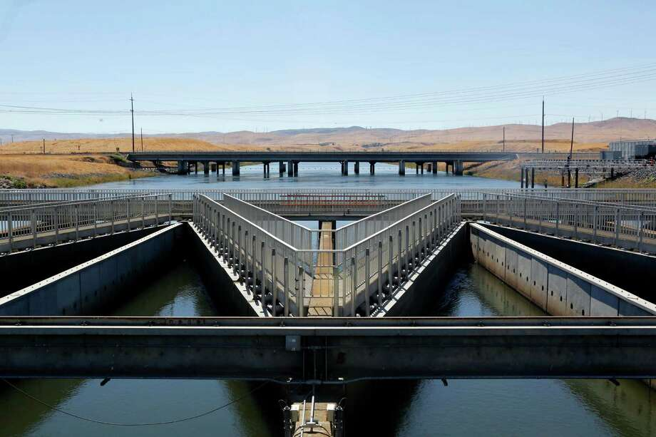 Pushing water back uphillIn California, during one of its worst droughts in history, officials are working out how to send water back uphill from the California Aqueduct to get the precious liquid back to farms. Photo: Rich Pedroncelli, AP / AP