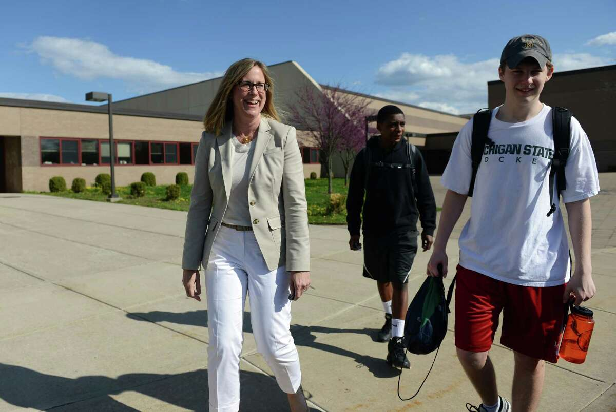 Allison Donaldson walks to her car with her son 15-year-old son Matthew while picking him and his brother up following volleyball practice at New Canaan High School Tuesday, May 6, 2014.